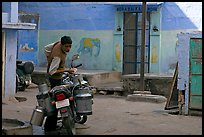 Man with milk delivery motorbike. Jodhpur, Rajasthan, India ( color)