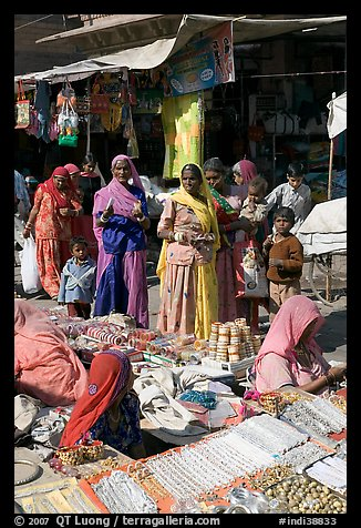 Women looking at jewelry stand in Sardar market. Jodhpur, Rajasthan, India (color)