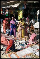 Women looking at jewelry stand in Sardar market. Jodhpur, Rajasthan, India ( color)