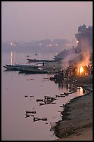 Cremation at Harishchandra Ghat at sunset. Varanasi, Uttar Pradesh, India (color)