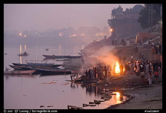 Cremation fire on banks of Ganges River. Varanasi, Uttar Pradesh, India (color)