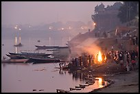 Cremation fire on banks of Ganges River. Varanasi, Uttar Pradesh, India