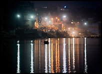 Ganges River at night with Ghat lights  reflected. Varanasi, Uttar Pradesh, India (color)