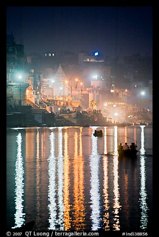 Lights reflected in the Ganga River at night. Varanasi, Uttar Pradesh, India