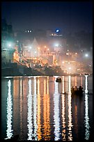 Lights reflected in the Ganga River at night. Varanasi, Uttar Pradesh, India ( color)