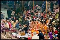 Brahmans standing amongst crowd at the begining of evening puja. Varanasi, Uttar Pradesh, India (color)