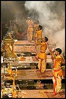 Young priests open Puja ceremony by blowing a conch-shell. Varanasi, Uttar Pradesh, India (color)