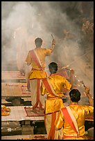 Brahmans standing amongst clouds of incense during puja. Varanasi, Uttar Pradesh, India (color)