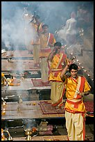 Five young Brahmans performing puja ceremony in the evening. Varanasi, Uttar Pradesh, India (color)