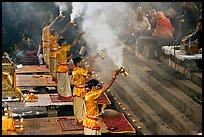 Hindu holy men performing religious arti ceremony. Varanasi, Uttar Pradesh, India (color)