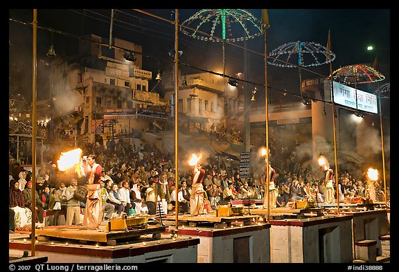 Pujari (priests) performing arti ceremony in front of large attendance. Varanasi, Uttar Pradesh, India (color)