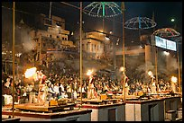 Pujari (priests) performing arti ceremony in front of large attendance. Varanasi, Uttar Pradesh, India