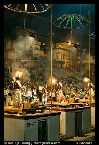 Holy hindu men facing audience during evening arti ceremony. Varanasi, Uttar Pradesh, India