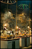 Holy hindu men facing audience during evening arti ceremony. Varanasi, Uttar Pradesh, India (color)