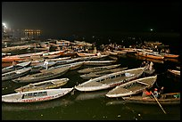Boats on the Ganges River at night during arti ceremony. Varanasi, Uttar Pradesh, India