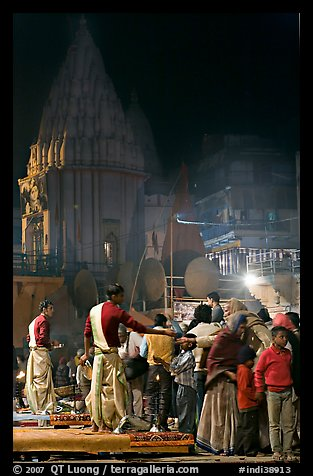 Brahmans giving blessings after evening arti ceremony. Varanasi, Uttar Pradesh, India