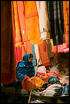 Woman selling fabrics at night. Varanasi, Uttar Pradesh, India ( color)