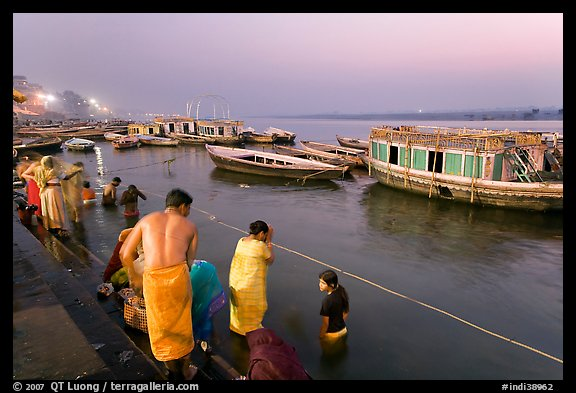 Ritual bath in the Ganga River at dawn. Varanasi, Uttar Pradesh, India