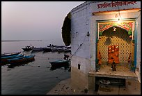 Shrine on the banks of the Ganges River at dawn. Varanasi, Uttar Pradesh, India ( color)