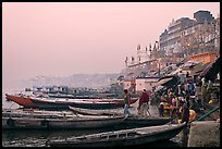 Boats and ghat at sunrise. Varanasi, Uttar Pradesh, India