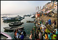 Activity on the steps of Dasaswamedh Ghat, early morning. Varanasi, Uttar Pradesh, India (color)