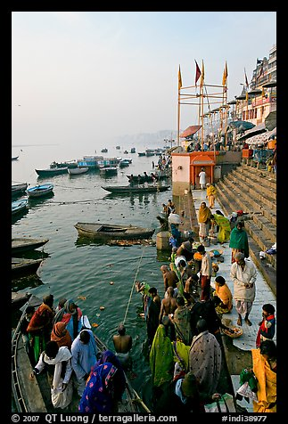 Boat unloading pilgrim onto Dasaswamedh Ghat, early morning. Varanasi, Uttar Pradesh, India (color)