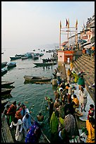 Boat unloading pilgrim onto Dasaswamedh Ghat, early morning. Varanasi, Uttar Pradesh, India