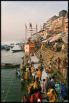 People about to bathe in the Ganga River at sunrise. Varanasi, Uttar Pradesh, India (color)