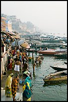 People and boats on the banks of the Ganges River, Dasaswamedh Ghat. Varanasi, Uttar Pradesh, India (color)