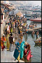 Gathering on the banks of Ganges River, sunrise. Varanasi, Uttar Pradesh, India (color)