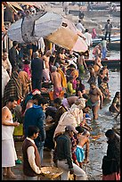Colorful crowd at the edge of water, Dasaswamedh Ghat. Varanasi, Uttar Pradesh, India (color)