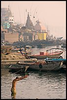 Man with arms stretched standing in Ganga River. Varanasi, Uttar Pradesh, India ( color)