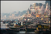 Boats and temples of Dasaswamedh Ghat, sunrise. Varanasi, Uttar Pradesh, India