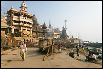 Manikarnika Ghat, with piles of wood used for cremation. Varanasi, Uttar Pradesh, India ( color)