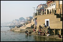 Men dipping in Ganga River at Meer Ghat. Varanasi, Uttar Pradesh, India