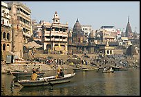 Rowboat and Manikarnika Ghat. Varanasi, Uttar Pradesh, India (color)