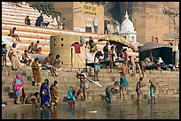 Hindu people on the steps of Sankatha Ghat. Varanasi, Uttar Pradesh, India (color)