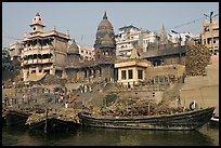 Huge piles of firewood stacked at Manikarnika Ghat. Varanasi, Uttar Pradesh, India ( color)