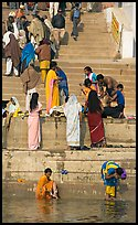Women rinsing in river Ganges water. Varanasi, Uttar Pradesh, India ( color)