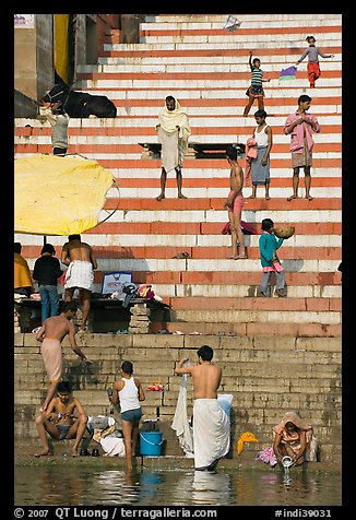 Drying out on stone steps of Meer Ghat. Varanasi, Uttar Pradesh, India (color)