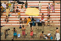 Men after bath on steps of Meer Ghat. Varanasi, Uttar Pradesh, India (color)