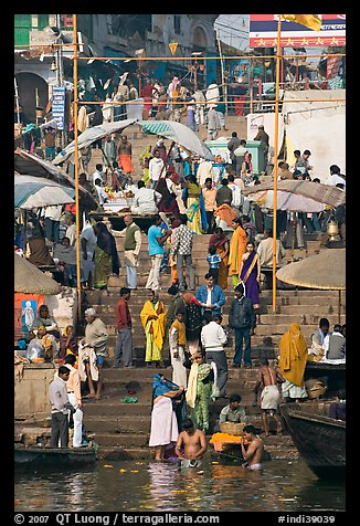 Colorful crowd on steps of Dasaswamedh Ghat. Varanasi, Uttar Pradesh, India
