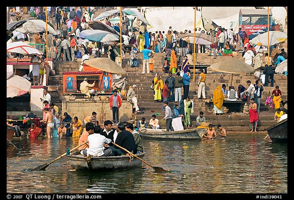 Boats and stone steps leading to Ganga River, Dasaswamedh Ghat. Varanasi, Uttar Pradesh, India (color)