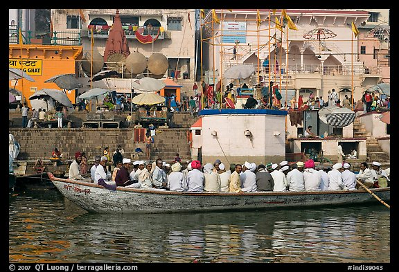 Boat packed with men near Dasaswamedh Ghat. Varanasi, Uttar Pradesh, India (color)