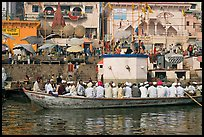 Boat packed with men near Dasaswamedh Ghat. Varanasi, Uttar Pradesh, India