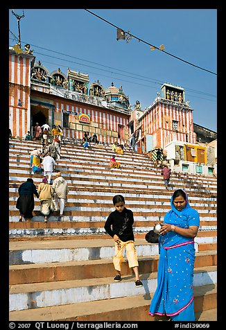 Woman and boy on temple steps, Kedar Ghat. Varanasi, Uttar Pradesh, India