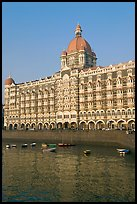 Taj Mahal Palace Hotel and small boats in harbor. Mumbai, Maharashtra, India (color)
