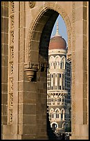 Taj Mahal Palace Hotel seen through arch of Gateway of India. Mumbai, Maharashtra, India (color)