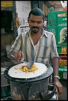 Man preparing breakfast dosa, Colaba Market. Mumbai, Maharashtra, India ( color)
