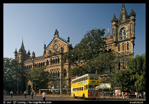 Yellow double-decker bus in front of Victoria Terminus. Mumbai, Maharashtra, India (color)